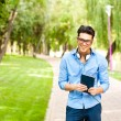 Handsome man wlaking in the park on a sunny day — Stock Photo