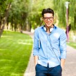 Handsome man wlaking in the park on a sunny day — Stock Photo #21437095