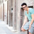 Handsome man smiling on the street — Stock Photo #21437109