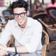 Attractive man wearing glasses standing at a terrace — Stock Photo #21437349