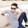 Attractive young male fashion model dressed casual - outdoor — Stock Photo #21437963