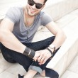 图库照片: Handsome male fashion model smiling, dressed casual - outdoor