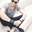 Stok fotoğraf: Handsome male fashion model smiling, dressed casual - outdoor