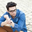 Handsome young man posing outdoors — Stock Photo #21438803