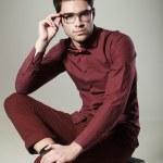 Handsome man dressed elegant posing in the studio — Stock Photo #21439999