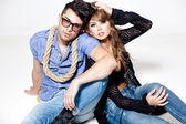 Sexy man and woman doing a fashion photo shoot in a professional studio — Foto de Stock