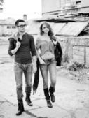 Sexy and stylish young couple wearing jeans (Photo has an intentional film grain) — Stock Photo