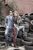 Sexy and fashionable couple wearing jeans, shoot in a grungy location - landscape orientation with copy-space — Stok fotoğraf
