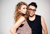Homem sexy e mulher fazendo uma sessão de fotos de moda — Foto Stock