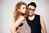 Sexy man and woman doing a fashion photo shoot — Stockfoto