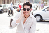 Handsome man smiling on the street — Stock Photo