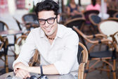 Attractive man wearing glasses standing at a terrace — Stock Photo