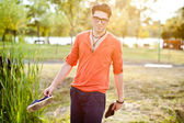 Attractive young male model posing outdoors — Stock Photo