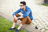 Handsome young man posing outdoors — Stock Photo