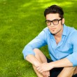 Handsome man standing on the grass — Stock Photo