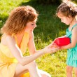 Stock Photo: Mother and daughter outdoors