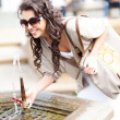 Beautiful girl drinking water from a fountain — Stock Photo
