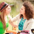 Two beautiful women drinking coffee and chatting on the river side terrace — Stock Photo #21445433