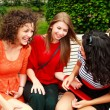 Stock Photo: Three beautiful women laughing and having fun