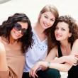 Foto Stock: Three beautiful women smiling