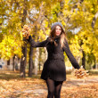 Beautiful young woman in the park autumn vibrant colors copy space — Stock Photo #21448755