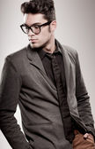 Attractive man dressed casual wearing glasses - studio shot, copy space — Stock Photo