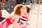 Mother and daughter on the playground — Stock Photo