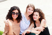 Three beautiful women smiling — Stock Photo