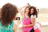 Three beautiful women photographing themselves — Stock Photo
