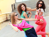 Three beautiful women laughing and having fun — Stock Photo