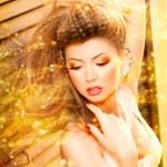 Very beautiful model wearing gold make-up — Stock Photo #21450465