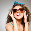 Stock Photo: Pretty girl with curly hair and perfect teeth