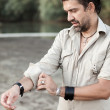 Man rolling up sleeves by the river- into the wild series — Stock Photo #21452719
