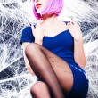 Sexy woman with purple wig and intense make-up trapped in a spider web - fashion shoot — Stock Photo #21453155