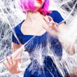 Sexy woman with purple wigh and intense make-up trapped in a spider web - fashion shoot — Stock Photo