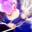 Sexy woman with purple wig and intense make-up trapped in a spider web screaming- fashion shoot — Stock Photo #21453597