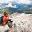 Cute girl taking pictures of beautiful panorama in the alps — Stock Photo