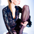 Sexy model dressed in lace blouse and elegant tights posing - fashion shoot — Stock Photo #21454241