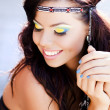Beautiful hippy woman smiling natural wearing colorful make-up — Stock Photo