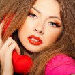 Hot sensual call girl talking on red telephone isolated on black — Stock Photo