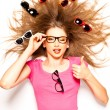 Stock Photo: Funny cute girl with curly hair and hipster glasses - conceptual