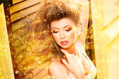 Very beautiful model wearing gold make-up — Stock Photo