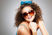 Pretty girl with curly hair and perfect teeth — Stock Photo