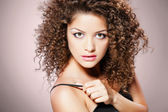Pretty girl with curly hair — Stock Photo