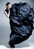 Beautiful woman model dressed in an elegant dress in a fashion pose — ストック写真