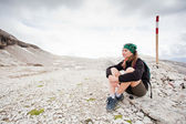 Cute girl hiking in the alps — Stock Photo