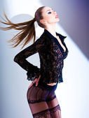 Sexy model dressed in lace blouse and elegant tights posing - fa — Stock Photo