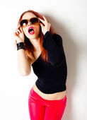 Sexy red haired woman, punk attitude posing in the studio — Stock Photo