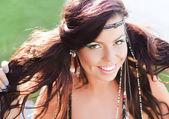 Beautiful hippy woman smiling natural wearing colorful make-up — Stock Photo