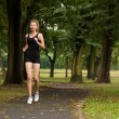 Stock Photo: Girl running in the park